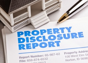 Property Disclosure Report with house and pen.